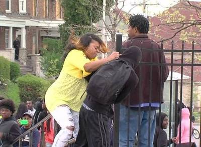 News video: Mother Beats Son for Participating in Baltimore Riots